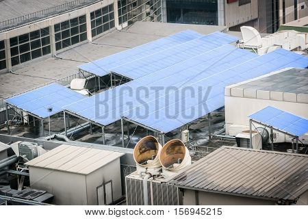 Solar cell panel on the rooftop of office or factory building.Solar power energy concept.