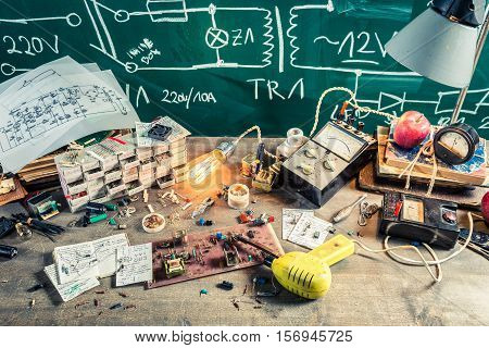 Old Electronics Workplace In School Lab On Old Wooden Table