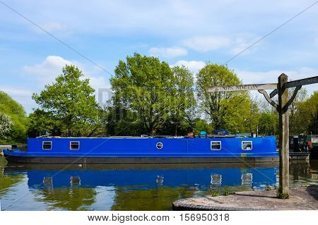 Blue British canal boat parked in a dock at Lapworth a Warwickshire village.