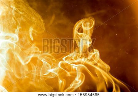 The smoke was burning. Abstract golden heat.