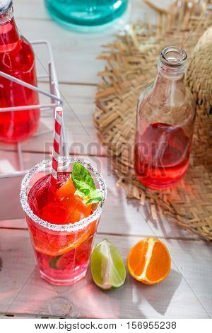 Cold Summer Drink In Bottle On Old White Table