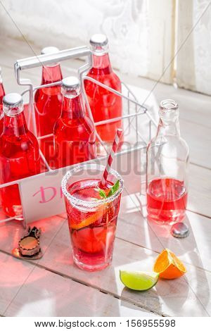 Cold Summer Drink In Bottle With Citrus Fruit