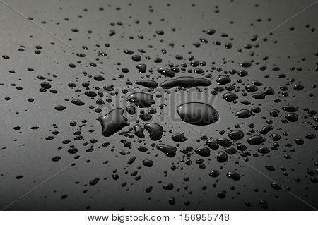Liquid or water drops silver splash on the black floor abstract background
