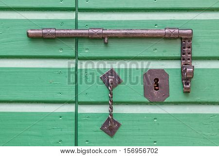 Detail of old wooden door lock of the typical house in Tucepi village, Croatia.