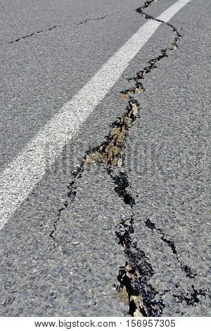 Kaikoura New Zealand - November 15 2016: Closeup of road cracks in the Hunderlee Hills on the road to Kaikoura following the 7.5 Kaikoura Earthquake this week.