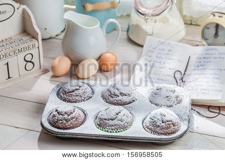 Decorating Sweet Cupcakes With Caster Sugar On Old White Table