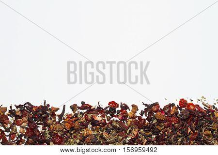 Loose leaf fruit tea on white background.