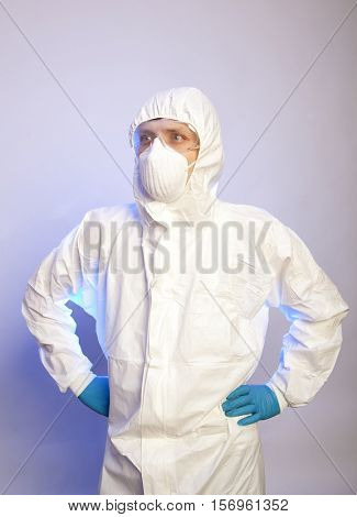 Virologist. Male professional in hooded suit for bio-hazard protection