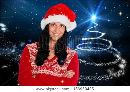 Portrait of beautiful woman in santa costume with arms crossed during christmas time