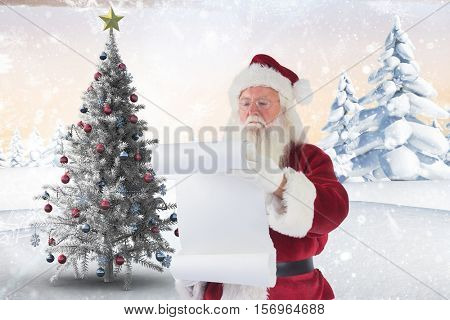 Santa claus reading letter during christmas time