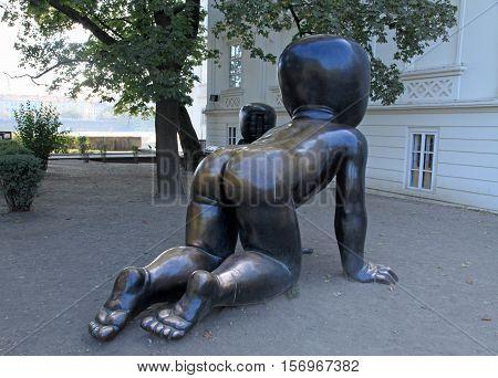 PRAGUE, CZECH REPUBLIC - OCTOBER 3, 2015: Hude modern Crawling baby sculptures by David Cerny, Prague, Czech Republic