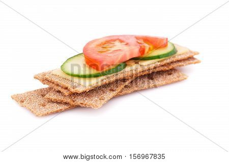 Crackers with fresh vegetables and cheese isolated on white background.