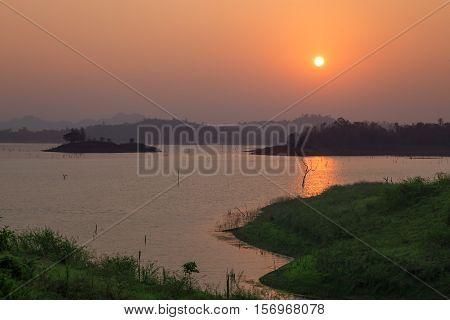 Sunset at the lake with a beautiful orange light. Pompey Kanchanaburi Thailand.