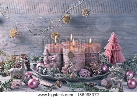 Four pink christmas candle for advent