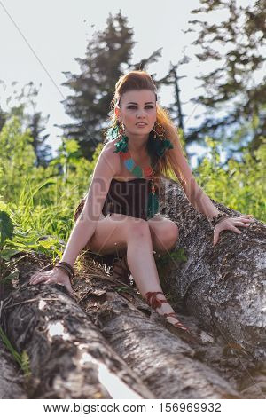 Young and beautiful savage girl in forest