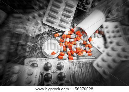 Pharmacy theme, Pharmaceutical medicament for health Drug ampules prescription for treatment medication. Heap of red orange white round capsule in stick pills with medicine antibiotic in packages