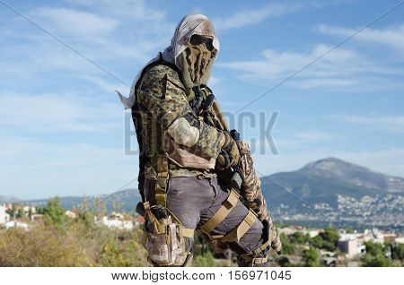 sniper aim target scope multicam ghillie suit,side view look on camera