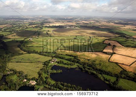 Aerial view, Gloucestershire countryside, England, Distant City