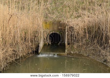 Gateway Between The Channels Of Irrigation System Rice Fields