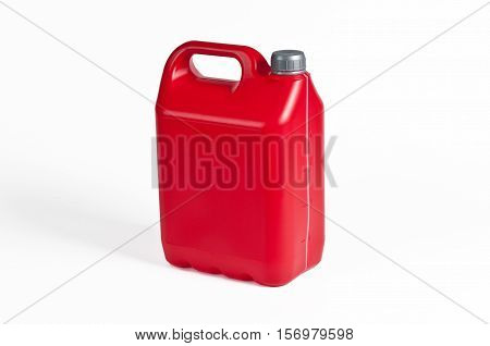 Red plastic jerrycan with grey cap on white background.