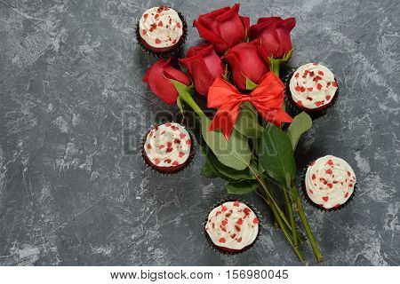 Sweet romantic cupcakes for Valentine's Day on a gray background