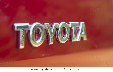 Hanoi, Vietnam - Nov 17, 2016: Close up of the logo of Toyota on the car front, taken within a test drive. Toyota Motor is a Japanese automotive manufacturer headquartered in Toyota, Aichi, Japan.