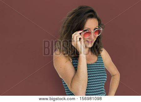 Girl woman wearing sunglasses on maroon background