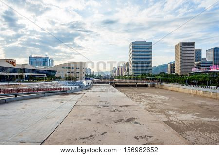 View On Empty River Bed And Xining Skyline, China