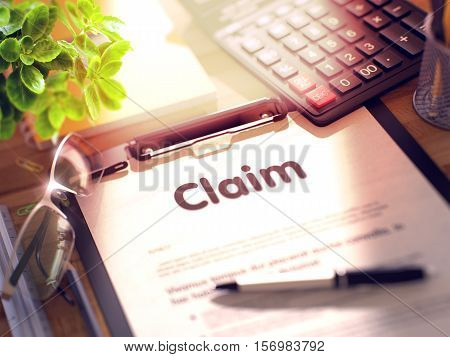 Claim- Text on Clipboard with Office Supplies on Desk. 3d Rendering. Blurred and Toned Image.