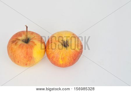 two orange apples with isolated background from Bangkok,Thailand