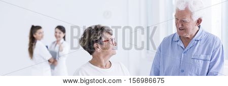 Older Woman And Man Talking