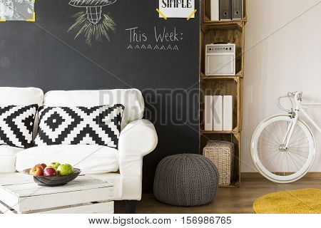 Fragment of a hipster room with wooden box furniture and a white bicycle