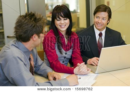 Team of business people having a meeting