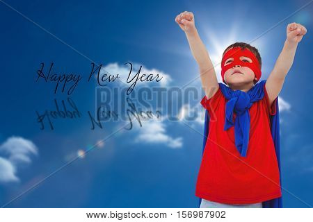 Masked boy pretending to be superhero against sky with sun