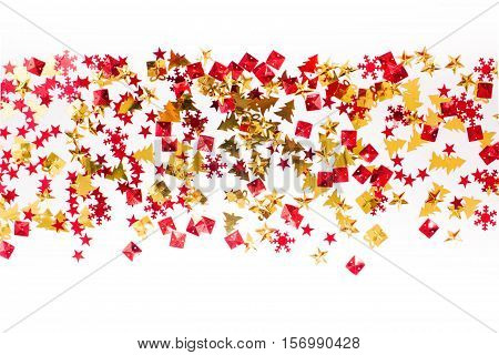 Christmas or New Year background: studded with red and gold sequins in the shape of a Christmas tree, gift and star. Place for your text.