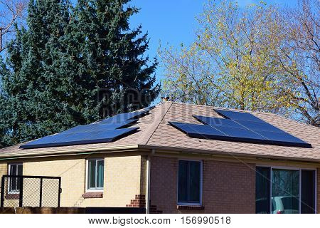 Middle Class older home with modern solar panels taken in a Colorado neighborhood