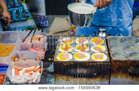 Taiwanese street food : Taiwanese style Egg burger with various condiments and flavour in night market