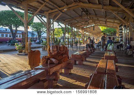 Nakhon Lampang, Thailand - November, 13, 2016 : Unidentified old monks thai passenger waiting for time to train at Nakhon Lampang Railway Station in Nakhon Lampang, Thailand.