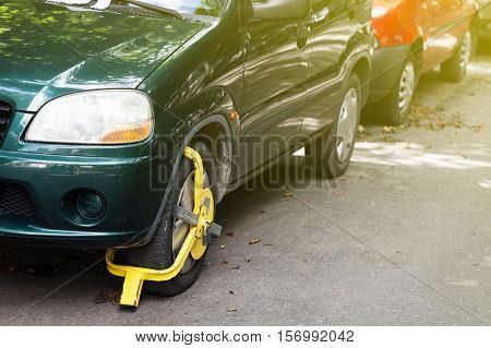 Wheel lock the car for safety the theft.