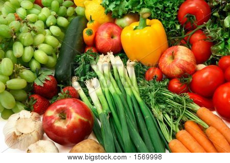 This is a close-up of vegetables and fruits. poster