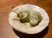 Boiled Japanese mollusk on a plate the horned turban poster