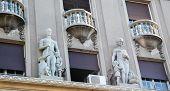 Jugendstil statues on a historic building in Belgrade Serbia. poster