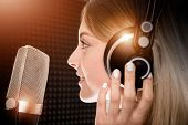 Female Voice Talent in Recording Studio. Girl Recording Voice Over For Radio Commercial. Young Girl in Her 20s and the Shiny Metallic Pro Microphone. poster