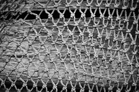 Fishing net closeup - black and white background.