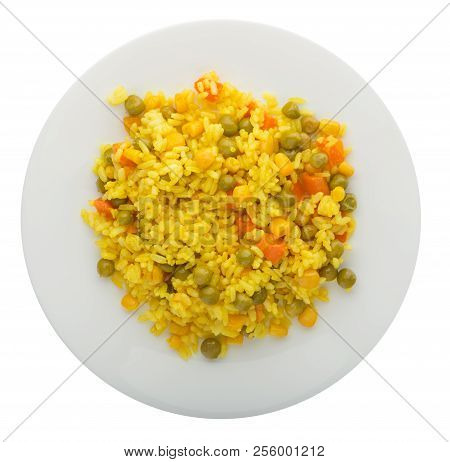 Yellow Rice With Carrots, Green Peas, Turmeric On A Plate. A Plate Of Rice Isolated On A White Backg