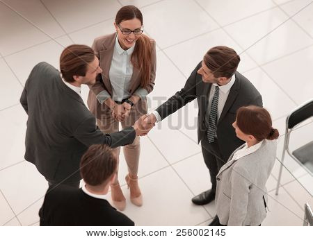 top view.handshake trading partners in the office