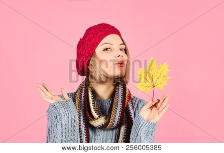 Sexy Woman In Red Hat Holds Maple Leaf. Woman In Warm Sweater Holds Gold Leaf. Woman With Autumn Lea