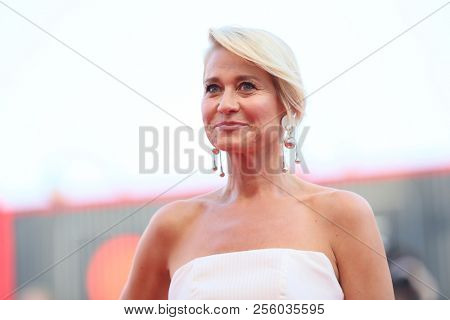 Trine Dyrholm walks the red carpet ahead of the opening ceremony during the 75th Venice Film Festival at Sala Grande on August 29, 2018 in Venice, Italy.