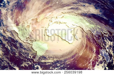 The Concept Of Catastrophic Climate Change, Huge Global Hurricane On The Background Of The World Map