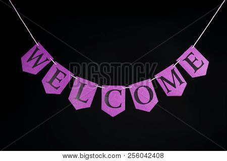 Welcome Home Banner. Pink Purple Greeting Letters Hanging On Bunting. Welcoming Text On String Again